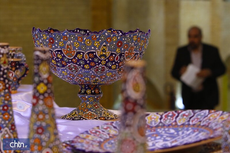 Sets of enameled pottery on display at Tehran exhibit